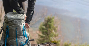 Hiking backpack being filled to provide comfort to the hiker